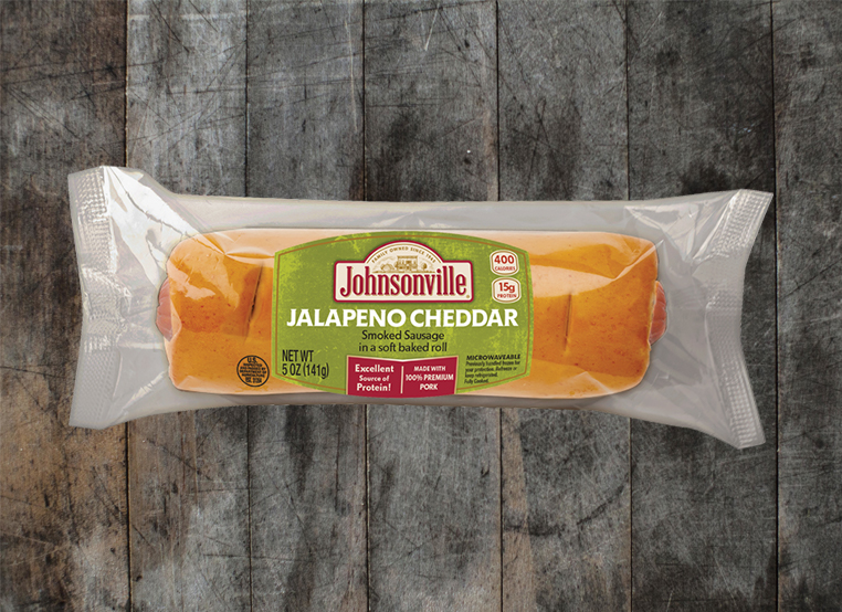 Spicy Sunrise Sausage in baked roll handheld sandwich by Johnsonville C-Store for convenience stores grab and go.