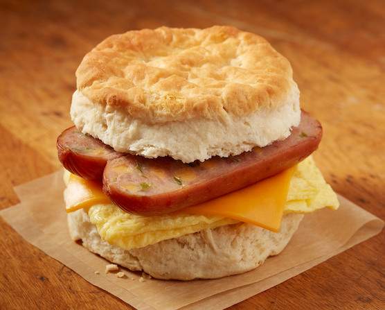 Johnsonville C-Store made to order breakfast sandwich using a biscuit, split sausage, scrambled eggs, and cheese.